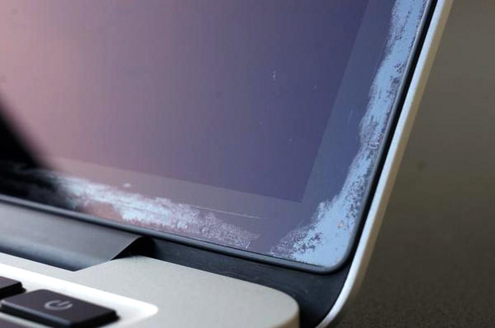 Solution écran macbook traces grises garantie